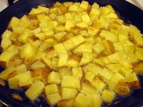 Frying the potatoes