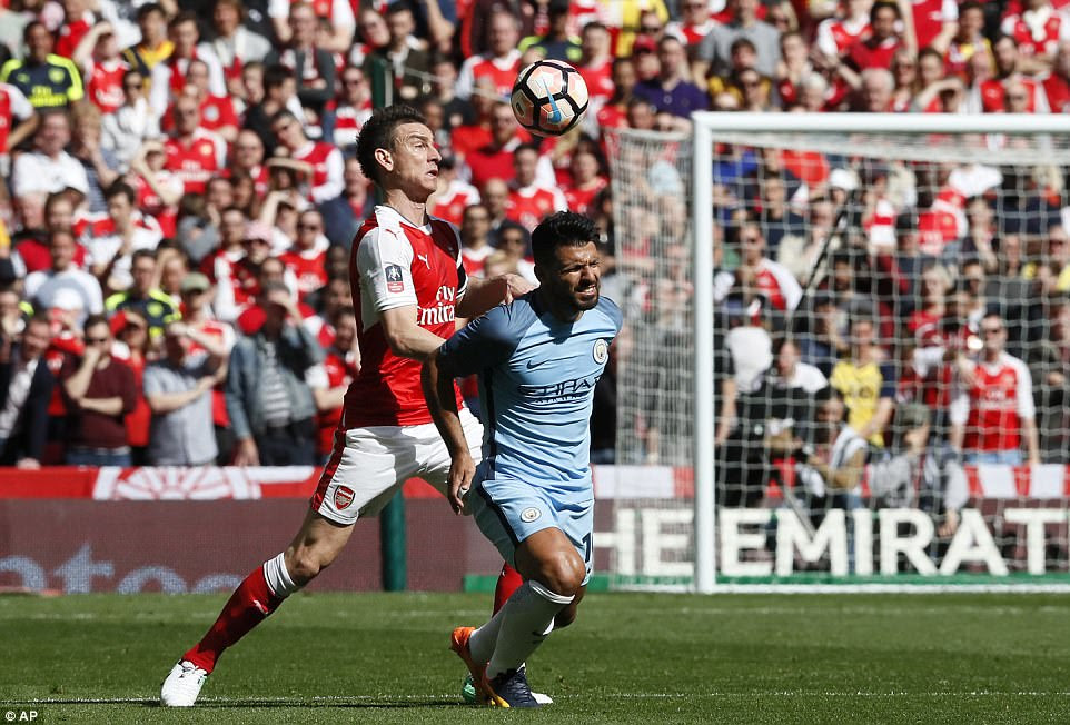 The challenges continue to fly in from both sides, however, as Aguero cops a hefty tackle from Laurent Koscielny