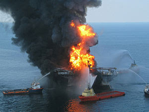Anchor-handling tugboats battle the blazing re...