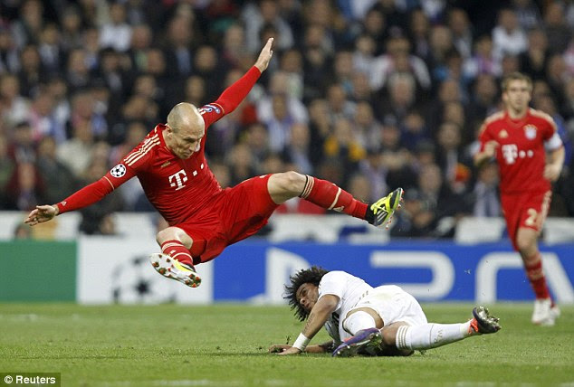 Over the top: Robben takes a tumble after a challenge by Madrid defender Marcelo