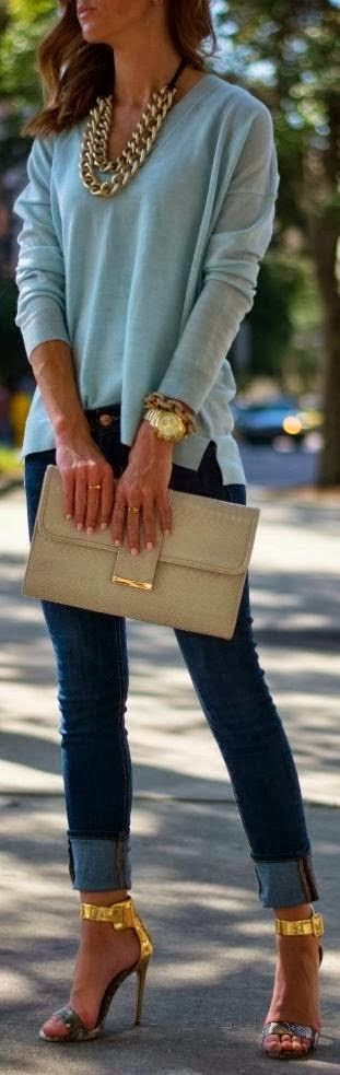 Fall fashion with high heels, clutch, chain necklace and rolled up jeans