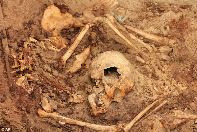 Horror: Skeletons, believed to be human sacrifices thrown into the tomb moments before it was sealed, were found alongside the mummified remains