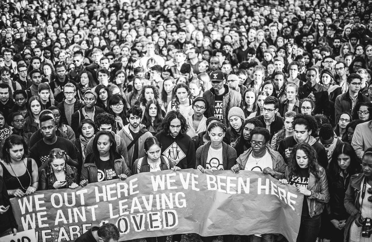 """One of the banners students marched with read: """"We out here. We've been here. We ain't leaving. We are loved."""""""