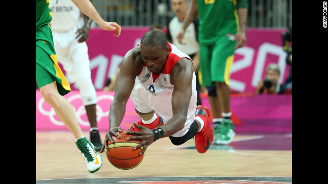 Luol Deng of Great Britain dives for the ball in the men's basketball preliminary match between Great Britain and Brazil.