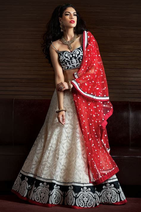 Beautiful Lehenga with contrast red dupatta. Check out at