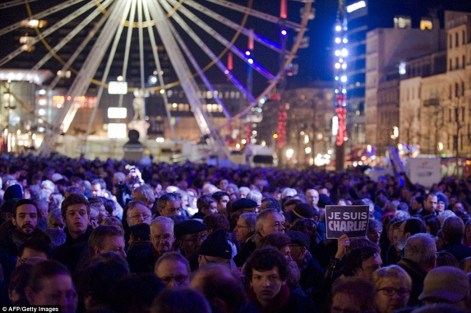 Gathering: A person holds a placard reading 'I am Charlie' in Clermont-Ferrand, central France, today during a rally in support of the victims