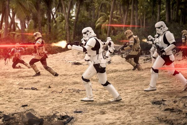 Imperial Shoretroopers and Stormtroopers fire at Rebel forces (off-screen) in ROGUE ONE: A STAR WARS STORY.
