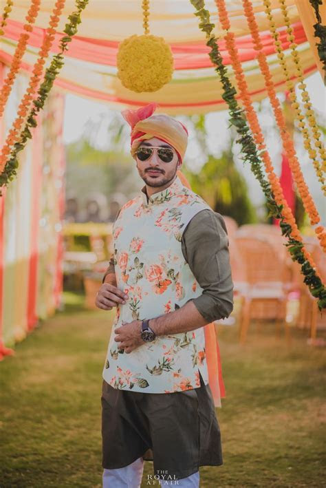 Mehendi groomwear with white and peach floral print nehru