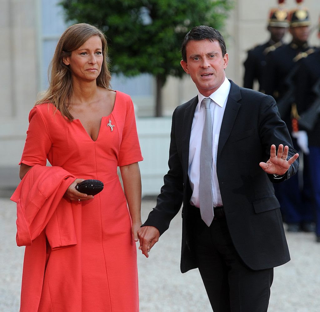 Manuel Valls, the the French interior minister, arrives at a state dinner with his wife Anne Gravoin, Sept. 3, 2013. (Antoine Antoniol/Getty Images)