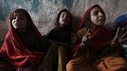 Girls attend class at a school in a slum on the outskirts of Islamabad, Pakistan
