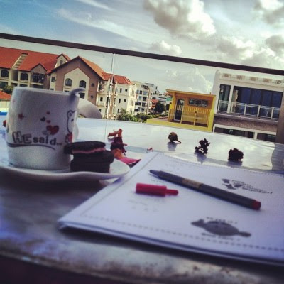 A cup of tea, oreo, blue sky and my work.  (Taken with Instagram)