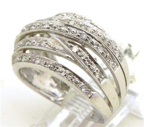 ladies  white gold diamonds criss cross ring bright