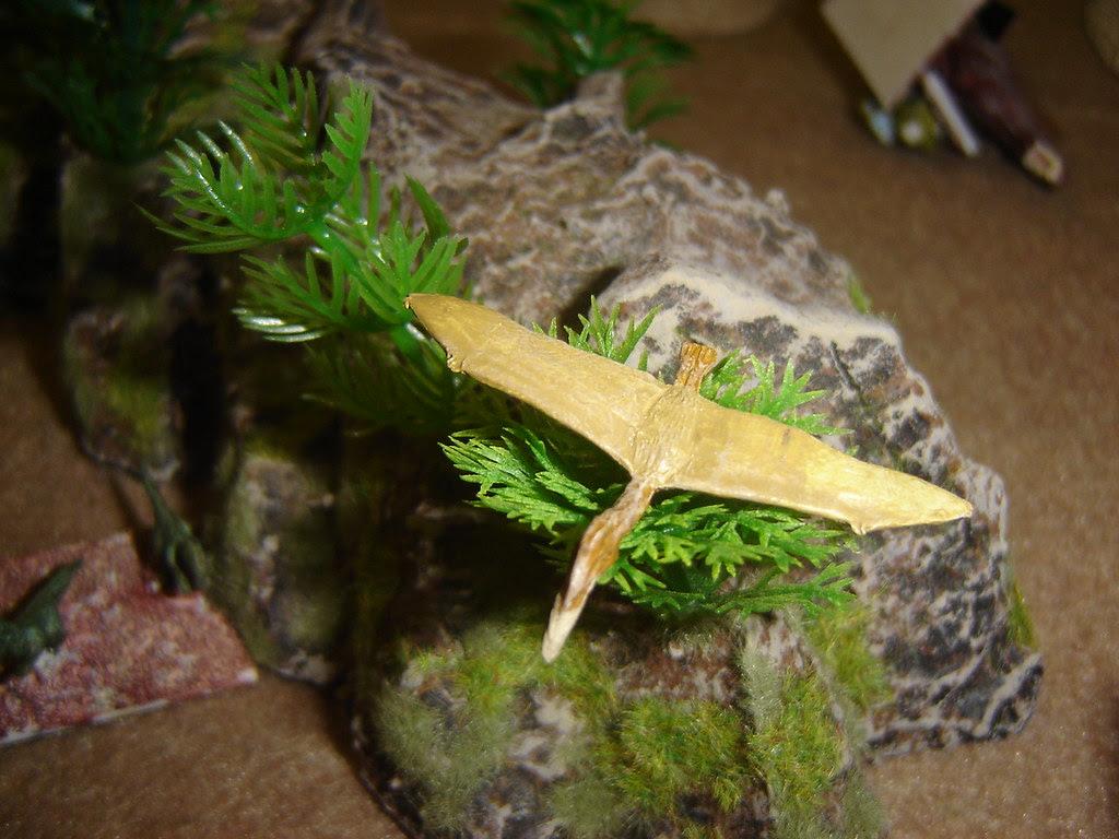 Pterodactyl lands on tree