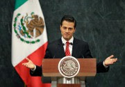 Enrique Peña Nieto, président du Mexique... (PHoto Rebecca Blackwell, Associated Press) - image 1.0