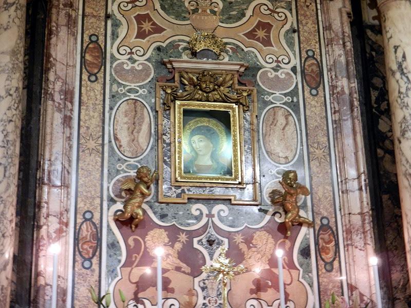 Den undergörande bilden Madonna del Pozzo.
