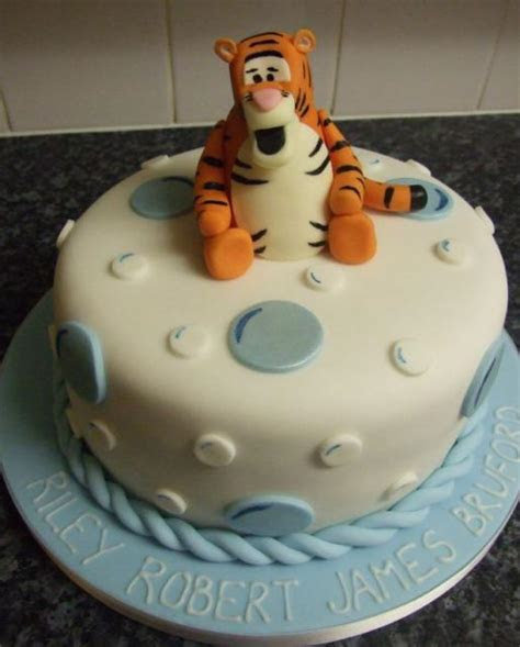 Tigger white round cake on powder blue base (1 comment