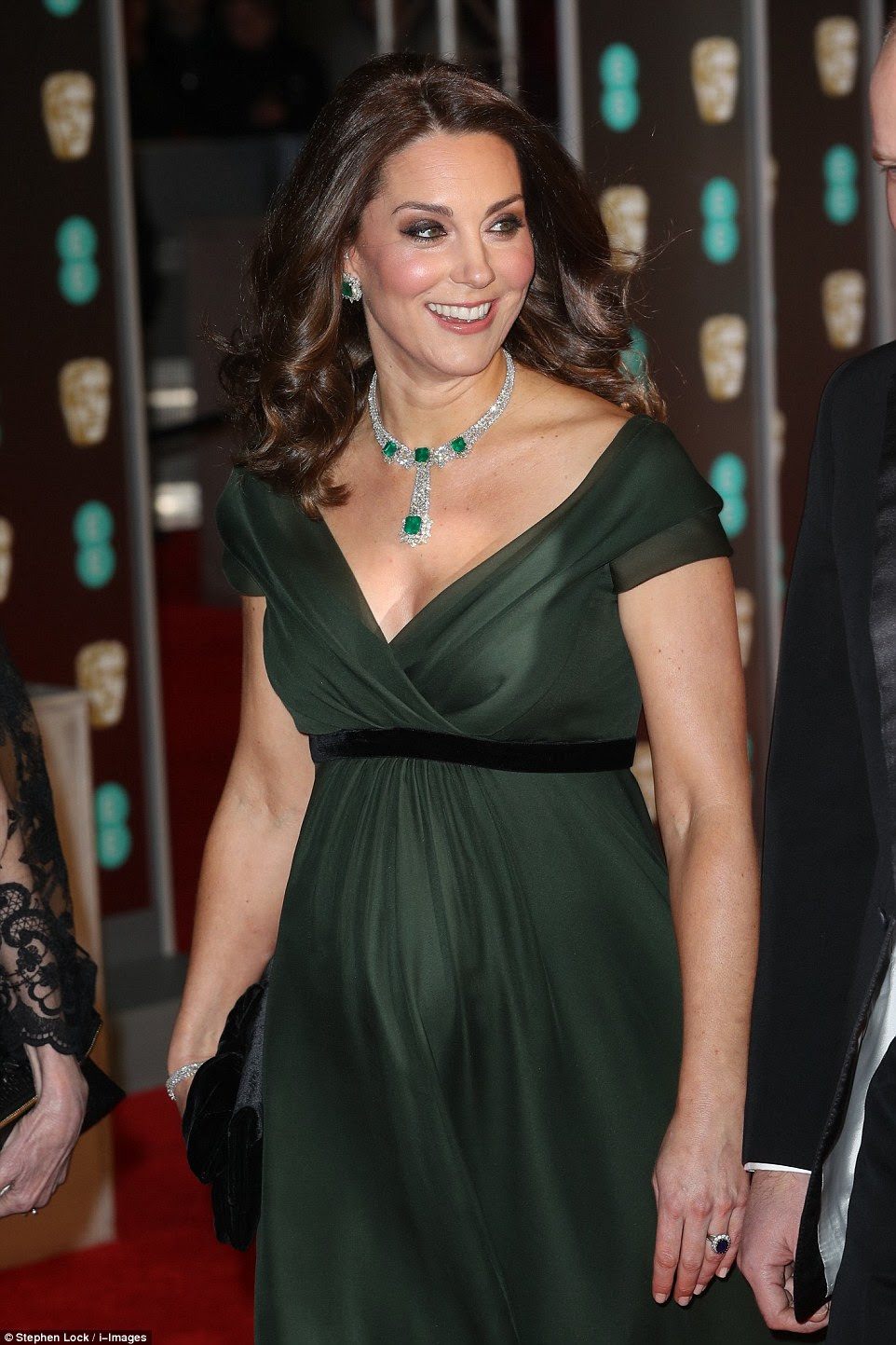 Green goddess: She wore an emerald dress to set off the garment, but a black ribbon demonstrated her support for the movement