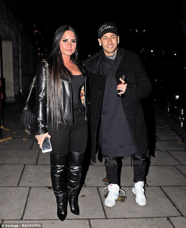 Party pals: Demi Lovato, 25, joined forces with a rising star in another industry, as she enjoyed a night out with sporting star Neymar in London on Tuesday night