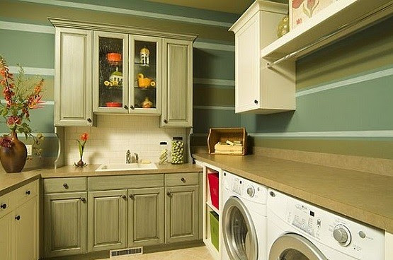 Laundry room with traditional storage cabinets