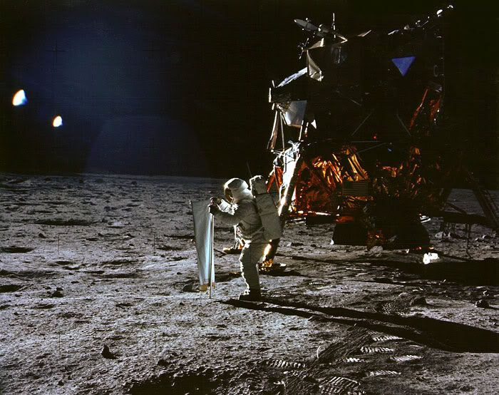 Astronaut Buzz Aldrin sets up a lunar experiment after he and Neil Armstrong became the first humans to set foot on the Moon, on July 20, 1969.