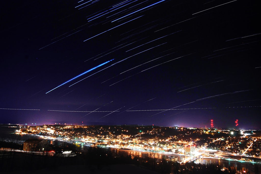 Star trails over the city of Houghton.