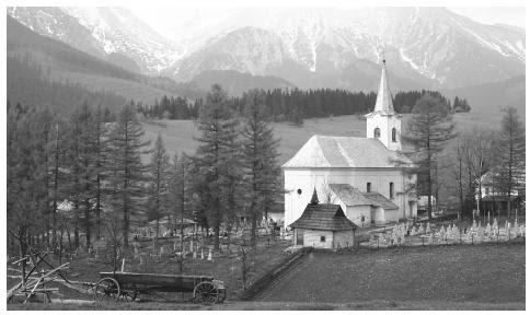 Mountains and trees surround a small white church and graveyard. Slovakia has extremely varied topography for its size; its elevation ranges from 308 feet (94 meters) to 8,722 feet (2,655 meters).