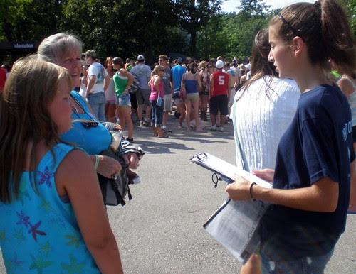 Volunteers talking to crowd