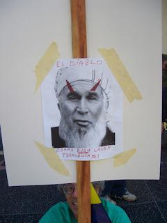"Photo: sign with Bush with a turban and devil's horns, saying, ""El Diablo; Osama Bush Laden, terrorista #1"""