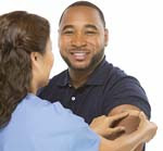 Smiling patient with nurse.