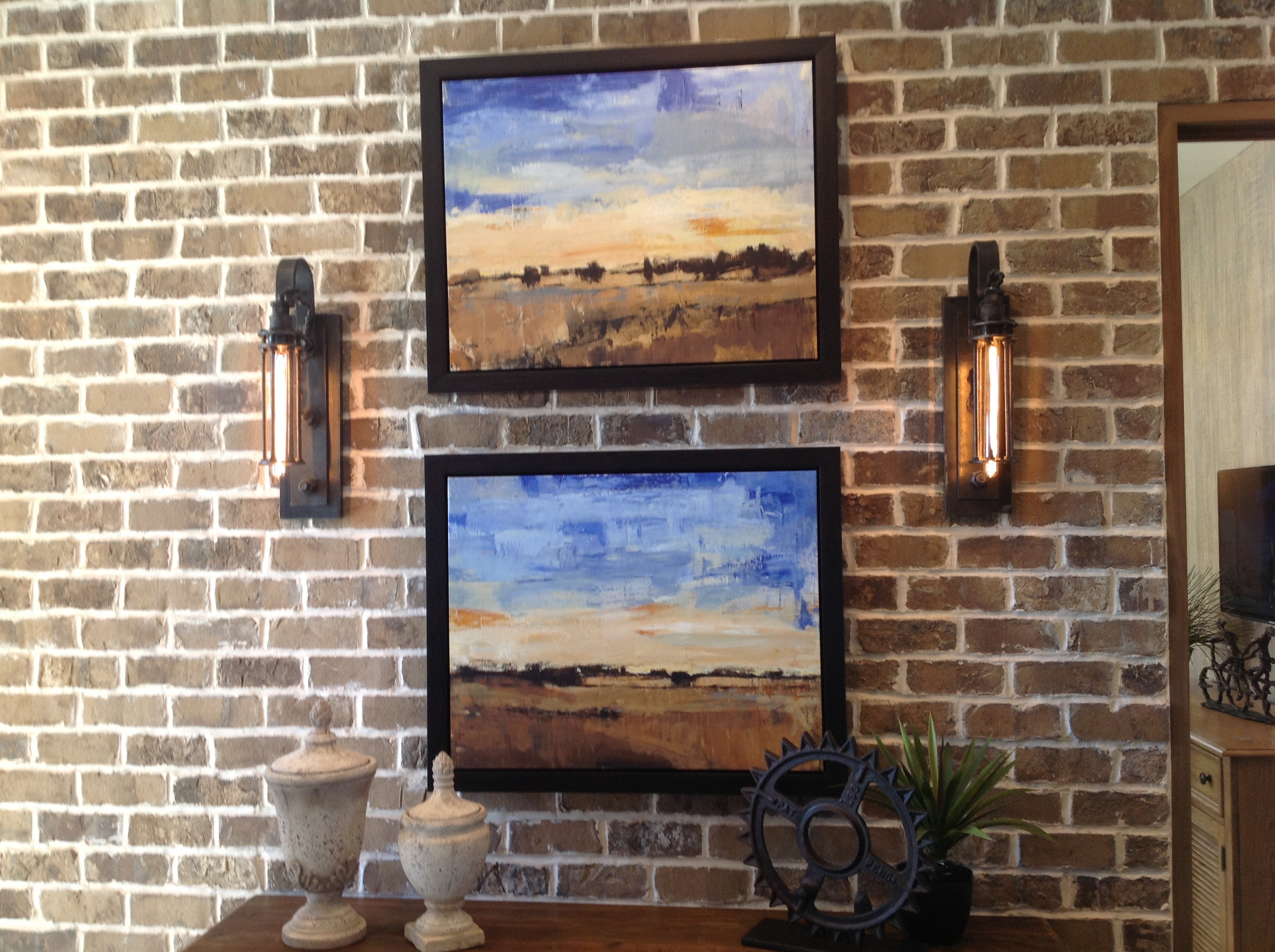 Fabulous Home Ideas – brick wall with sconces and pictures
