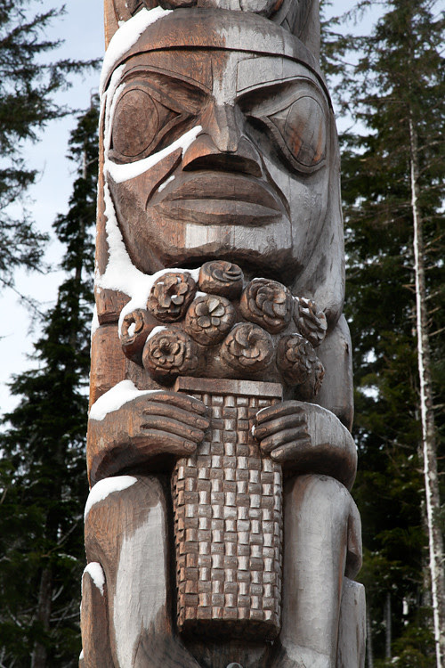 figure holding a basket of roses, The Unity Pole, Kasaan, Alaska