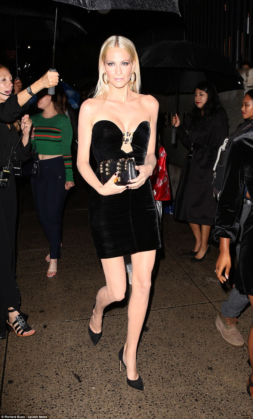 A vision in velvet: Poppy was displaying her endless legs in the scanty velvet mini dress