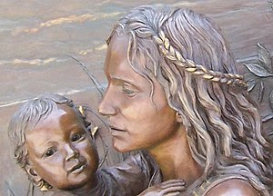 Faces of mother and child; detail of sculpture...