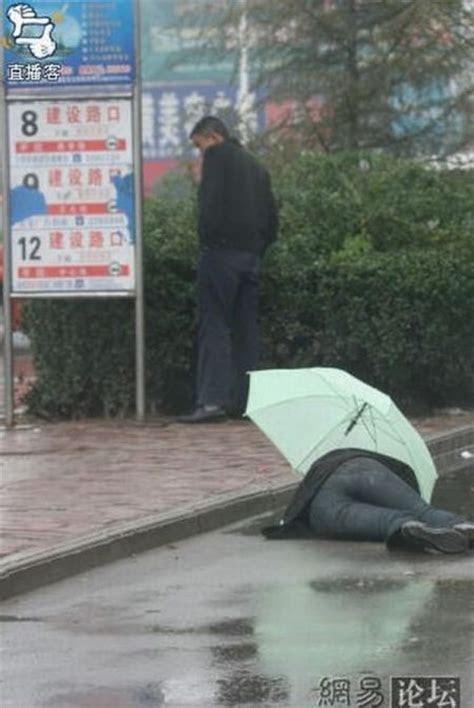 drunk japanese man middle  road  rain xcitefunnet