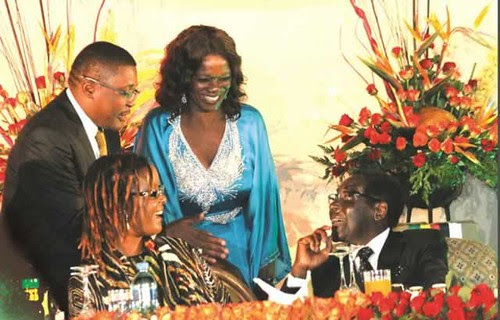 President Mugabe and the First Lady Amai Grace Mugabe being congratulated by Tourism and Hospitality Industry Minister Walter Mzembi and his Zambian counterpart Ms Sylvia Masebo after delivering his speech at the official closing ceremony of the 20th Sess by Pan-African News Wire File Photos