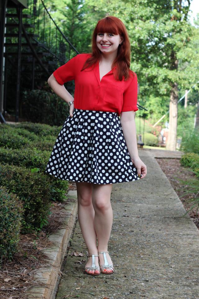 Polka dot skirt, red shirt, silver sandals