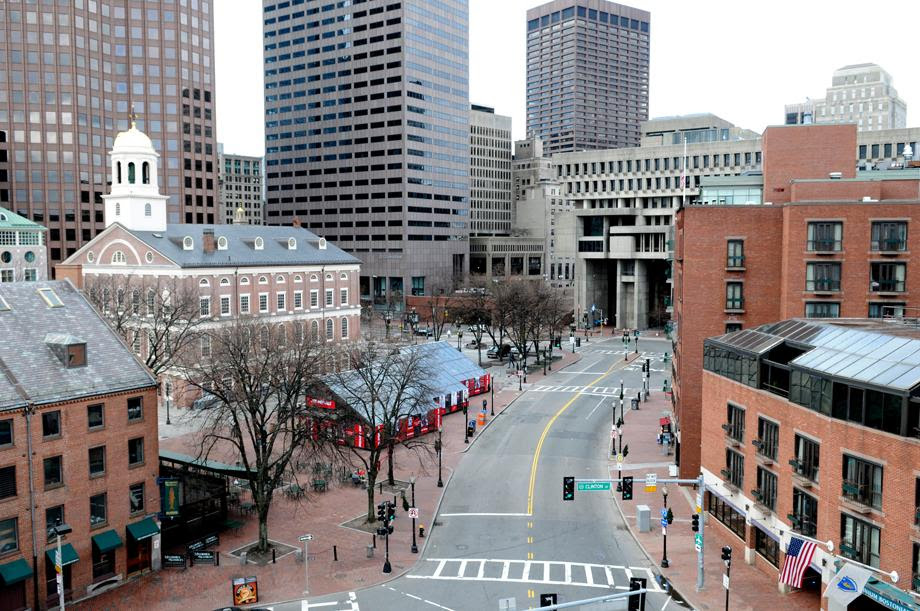 An empty street is seen near the historic Faneuil Hall (on L, with white cupola) and City Hall (back, in C) in Boston, Massachusetts on April 19, 2013, as the manhunt continues for Dzhokar Tsarnaev, the remaining suspect in the Boston Marathon bombings. Police killed one suspect in the Boston Marathon bombing, Tamerlan Tsarneav, in a shootout and mounted house-to-house searches for the second man, his brother Dzhokar Tsarnaev, on Friday, with much of the city under virtual lockdown after a bloody night of shooting and explosions in the streets.