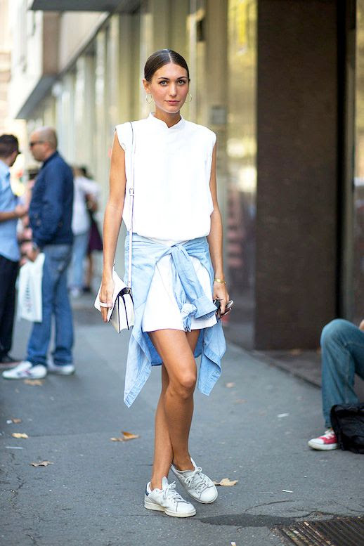 Le Fashion Blog Street Style Mfw White Sleeveless Shirtdress Crossbody Bag Denim Jacket Tied Around The Waist Sneakers Easy Summer Look Via Harpers Bazaar