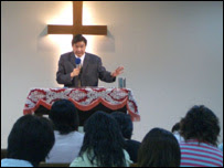 Pastor Lu and his congregation
