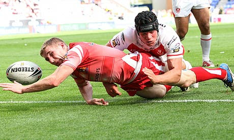 Wigan's Sam Tomkins drops the ball just before the try line as he is tackled by Saints' Jonny Lomax