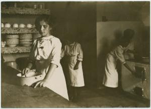 [Kitchen scene. Young woman in... Digital ID: 1536557. New York Public Library