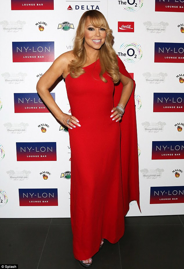 Lady in red:Mariah Carey attended the official afterparty of her London concert on Wednesday in a showstopping, superhero-inspired dress