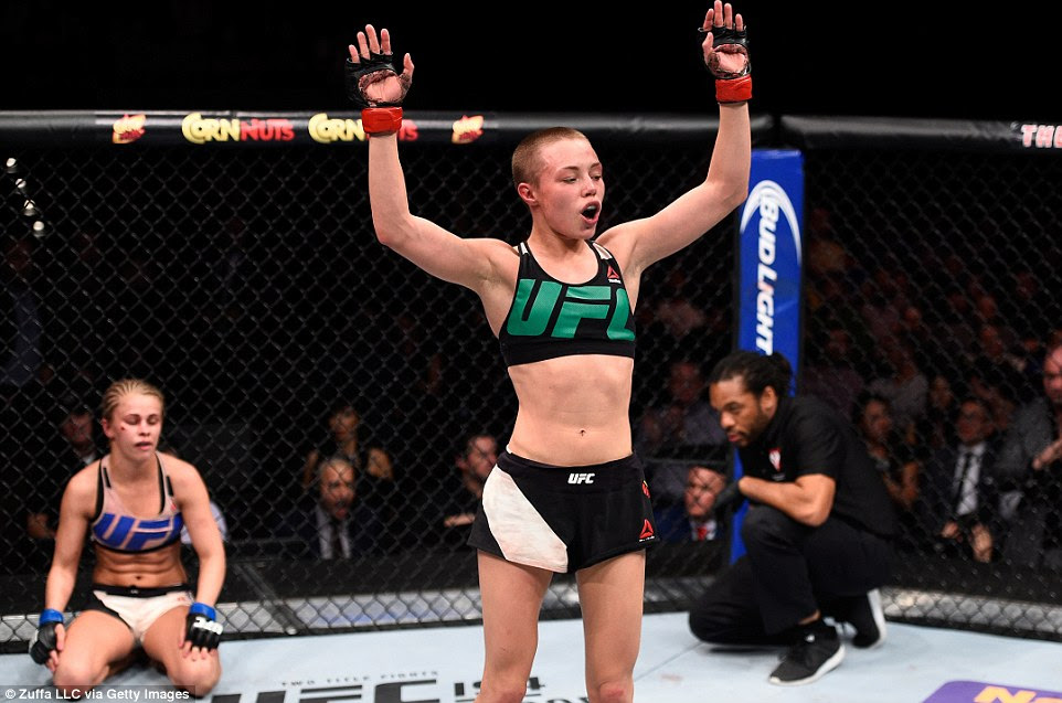 Namajunas celebrates her submission victory inside the Octagon while VanZant looks dejected