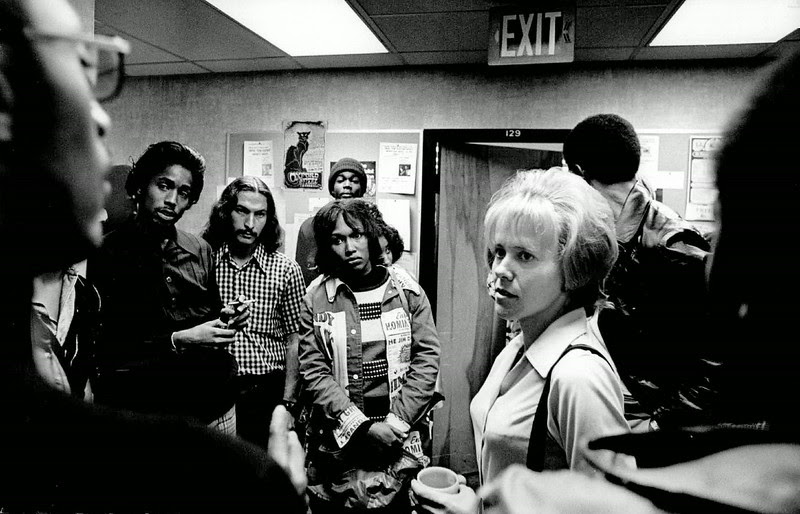 Description of  OCT 24 1974 - Editor Marguaret Peterson, Center, Discusses Cartoon With Members Of Black Group. Controversy over cartoon in the Metropolitan State paper arose through differing interpretations of meaning. (Dave Buresh/The Denver Post)