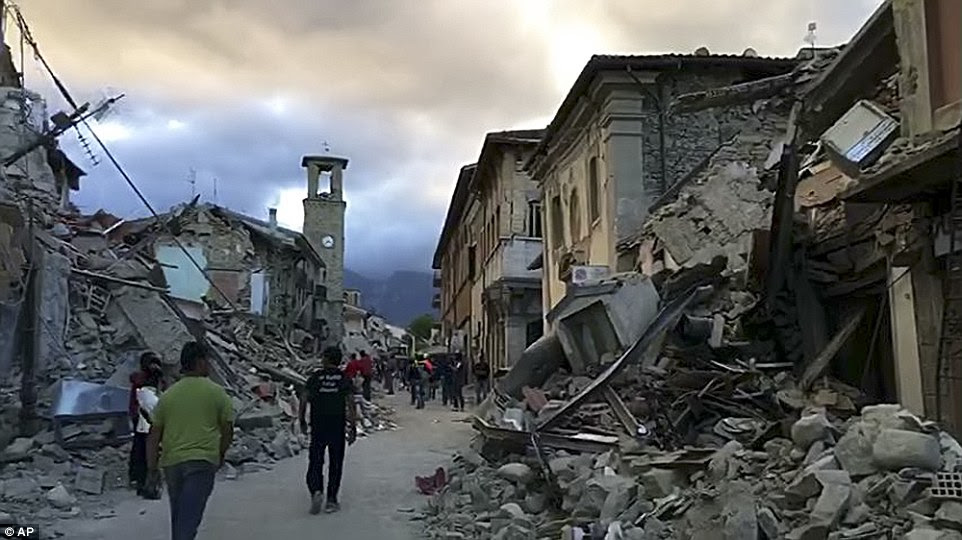 Aftermath: Residents of Amatrice in central Italy has been left in ruins overnight in an earthquake that shook areas up to 100 miles away, including Rome