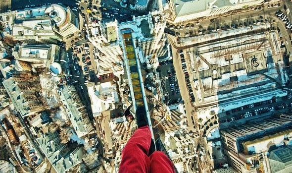 dizzying photos of ukrainian daredevil hanging from tall buildings 05 in Dizzying Photos of Ukrainian Daredevil Hanging from Tall Buildings