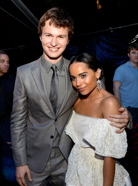 """Actor Ansel Elgort (L) and actress Zoe Kravitz pose at the after party for the premiere of Summit Entertainment's """"Divergent"""" at The Armand Hammer Museum on March 18, 2014 in Los Angeles, California."""