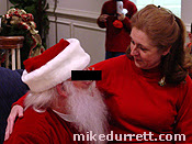 Photo: Mrs. D. caught with perpetrator in his oh so trendy red suit.