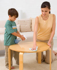 Photo: Boy and mom desinfecting a table
