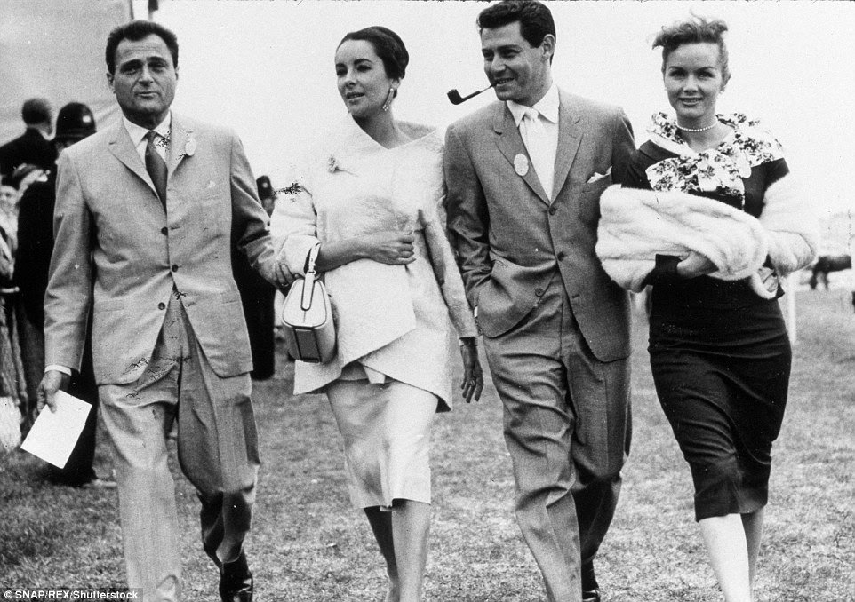Reynolds encouraged her husband to comfort Taylor after the death of Michael Todd, her third husband who was killed in a plane crash. The two couples are seen above together in 1957